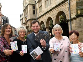 Some of the lucky winners collecting their prizes from Seb Slater, Executive Director of Shrewsbury BID