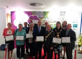 Shrewsbury and Oswestry celebrate their achievements at the awards ceremony in Belfast. Photo: Helen Ball