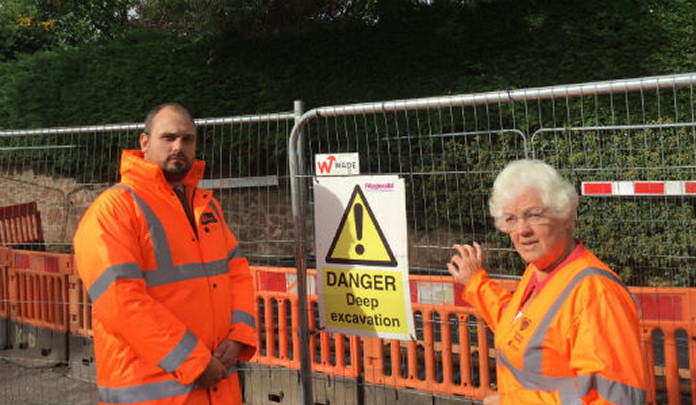 Telford & Wrekin Council's Network Group Manager Matt Powell and Councillor Hilda Rhodes, cabinet member for Transport, at the fenced off culvert site