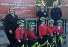Mrs Jordan (Deputy Head at Colsterworth Primary School), Benjamin Smith (Balanceability) and Vincent Brittain (Inspire+) with pupils from Colsterworth Primary School