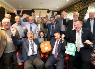 Wellington Rotarians give a big cheer after helping to buy a defibrillator for hikers and hotel guests pictured with (front)Wellington Rotary president Peter Williams, hotel general manager Wayne Jenson and Paul Watts, of SP Services, at the Buckatree Hall Hotel at the foot of The Wrekin