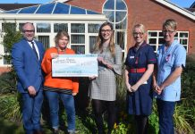 Members of the Rosewood Pet Products team present a cheque to Severn Hospice