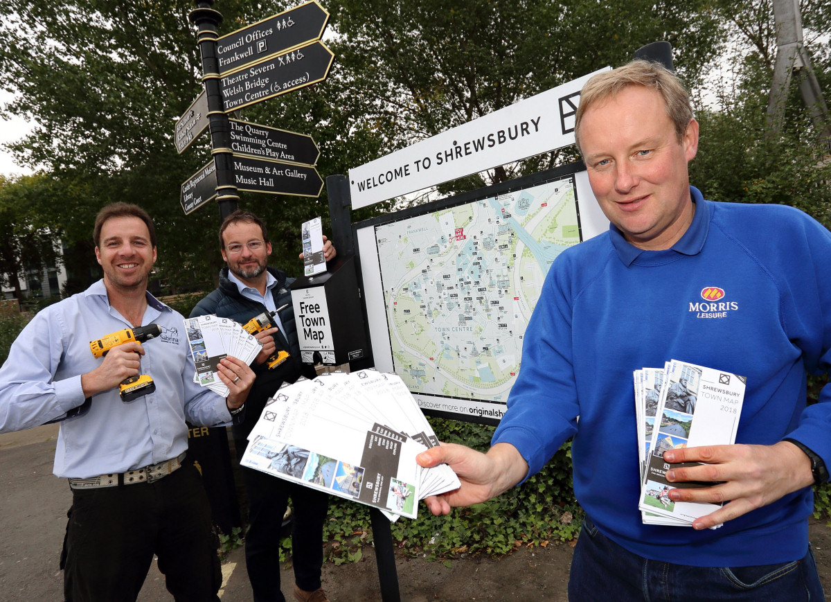 Edward Goddard (right), Dilwyn Jones and Mark Bebb from Shrewsbury Tourism at one of the Shrewsbury Town Map dispenser sites at Frankwell Car Park