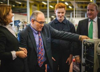 Robert Halfon chats with a Telford College engineering student at the Haybridge campus with local MPs Lucy Allan and Mark Pritchard