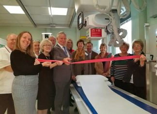 Mayor Tim Gill cuts the ribbon to open the X-Ray Suite, surrounded by hospital staff and members of the Ludlow League of Friends