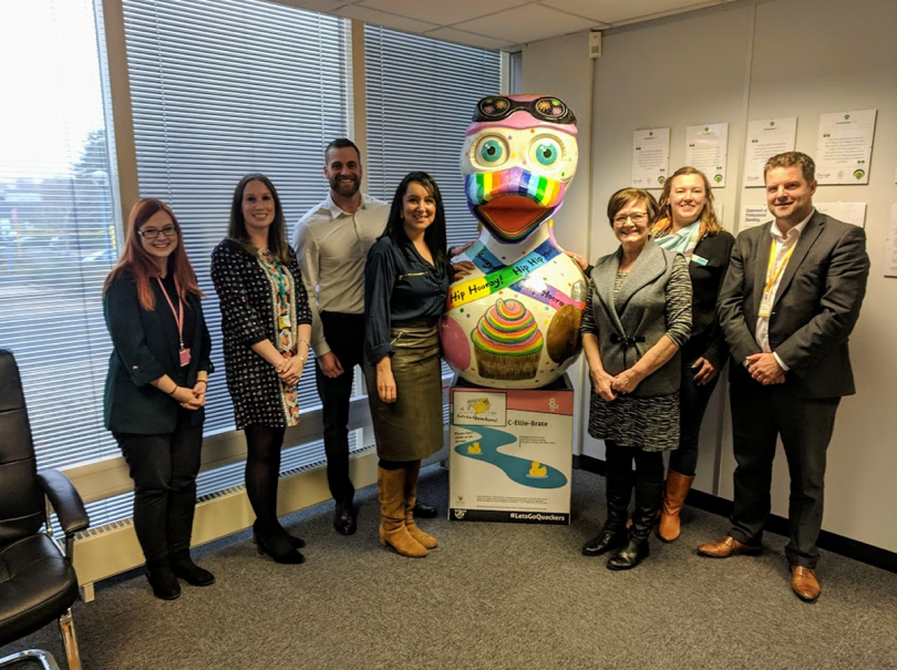 The giant duck pictured here with Rachel Lewis (Hope House), Lucy Ruff (Severn Hospice), James Tomlinson (marketing manager Pensionlite),  Sara Bennett (Jayne Sargent Foundation), Jan Hawthorne, Naomi Atkin (Lingen Davies) and Simon Cater (Compton Care) will be carried up The Wrekin