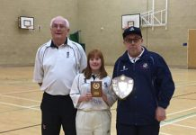 Georgie is pictured receiving her award from Graham (left) and League Chairman Ian Halford