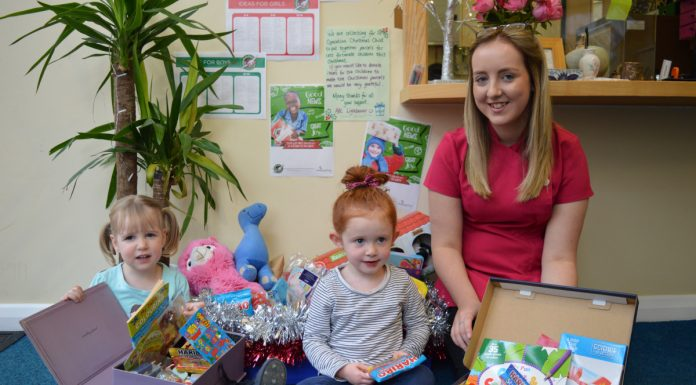 Two year old Evelyn Baxter, three year old Ida Banks and nursery practitioner Alicia Biddulph at ABC Day Nursery in Lightmoor preparing the shoeboxes for Operation Christmas Child