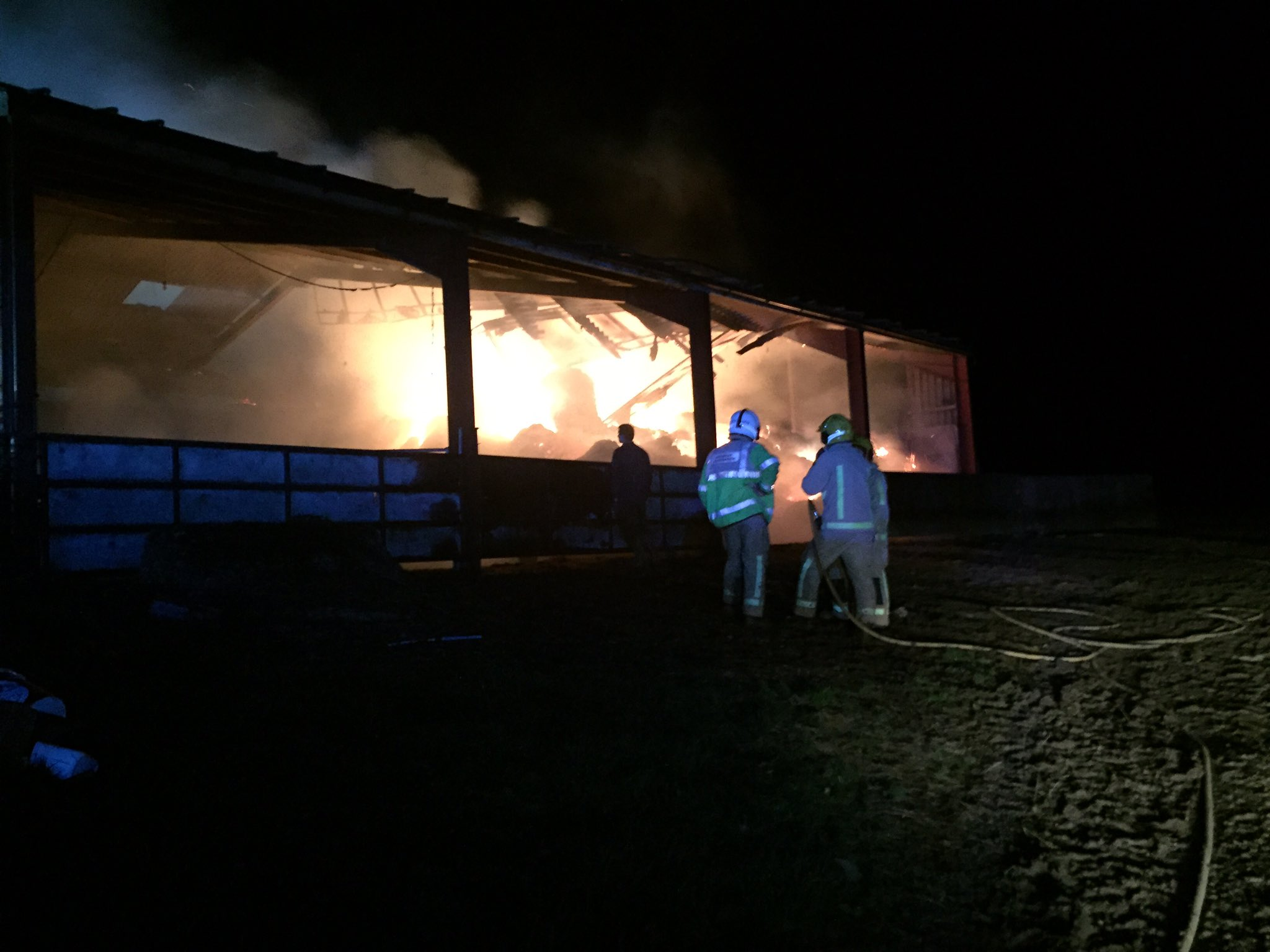 Firefighters work at the scene of the fire in Shipton. Photo: @SFRS_CravenArms