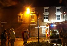 Firefighters at the scene of the fire in Market Drayton. Photo: @SFRS_NGriffiths