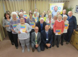 Steve (left centre front) and Andy (right centre front) with some of the volunteers receiving their awards at Hope House