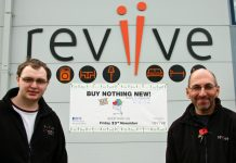 Dan Wood, volunteer and Simon Hilton, store manager, outside Reviive, Shrewsbury