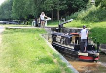 Shropshire Union Canal boat using lock at Audlem