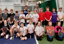Some of the youngsters who enjoyed taking part in the Budgen Motors schools day at The Shrewsbury Club line up with tennis coaches Simon Haddleton and Henry Broadhurst. Photo: Richard Dawson Photography