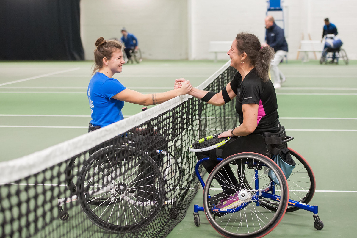 Lauren Jones, left, who made it a hat-trick of national women's singles titles at The Shrewsbury Club last year, shakes hands with local player Deena Webster. Picture: Richard Dawson Photography