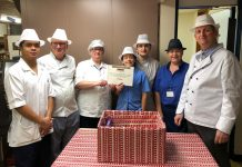 One of the catering teams with a food bank donation box