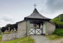 Lych gate to the east of the Church of St John the Evangelist, Newcastle on Clun, Shropshire has been listed at Grade II in 2018. Photo: Historic England