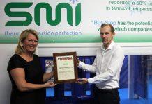 Lewis Davies and Jill Seymour receive the award on behalf of SMI