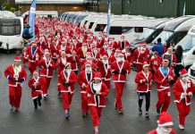 A wave of red sets off on the Salop Santa Dash on Sunday