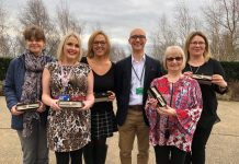 Some of the long-serving staff who received their awards from Chair of Trustees Steve Henly (centre) are (l-r) Karen Murray, Louise Bowen, Simi Epstein, Lyn Jones and Alison Marsh