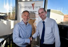 Outgoing CEO, David Coull, congratulates Chris Wall on his appointment as chief executive of Coverage Care Services