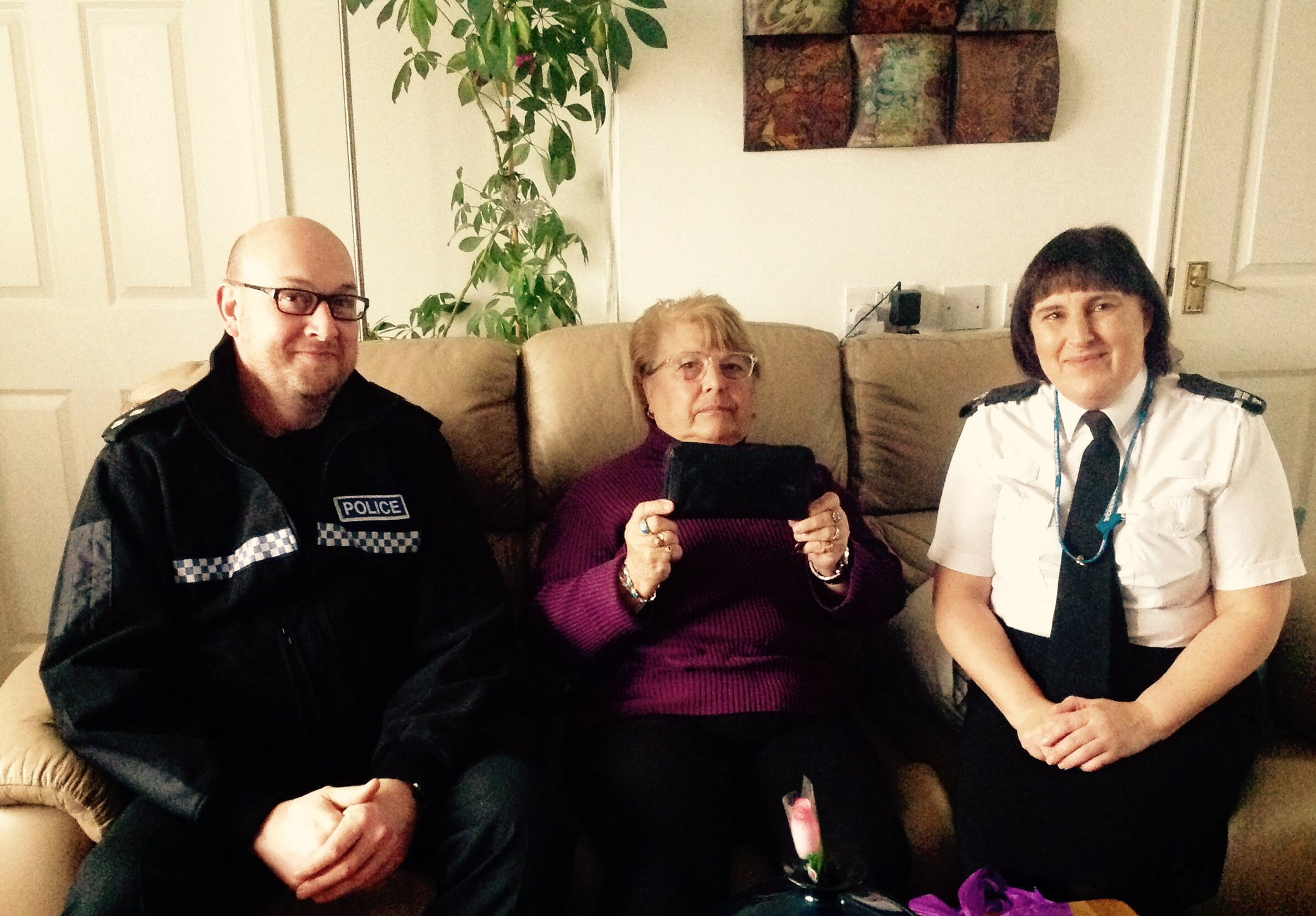 Police officers Tanya Lewis and Rich Bailey have returned the purse to Cathleen. Photo: West Mercia Police