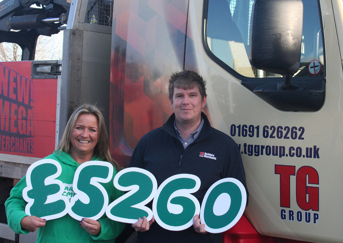 Kate Thomas from Macmillan Cancer Support and Paul Morris, branch manager at TG Builders' Merchants Oswestry