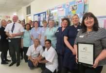 The ward team is presented with their certificate by Deirdre Fowler, Director of Nursing, Midwifery and Quality at SaTH