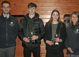 Ed Glover and Laura Wilde of Salop Leisure present trophies to Kati Hulme and Bradley Davies-Pughe, highest ranked Shrewsbury Athletic Club athletes on the UKA Power of 10