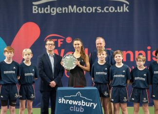 Vitalia Diatchenko, the singles champion, with, left, James Martin, the managing director of tournament sponsors Budgen Motors, and David Rawlinson, the deputy president of the LTA, at the presentation ceremony, together with members of the ball crew. Photo: Richard Dawson Photography