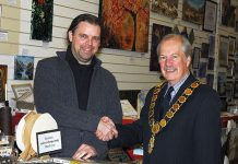 Councillor Peter Nutting, Mayor of Shrewsbury, with Mike Hatch of the Vision Gallery in The Darwin Shopping Centre