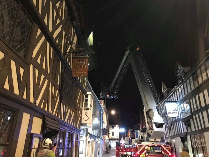 Firefighters use an aerial ladder to deal with the chimney fire in Bridgnorth. Photo: SFRS_Bridgnorth