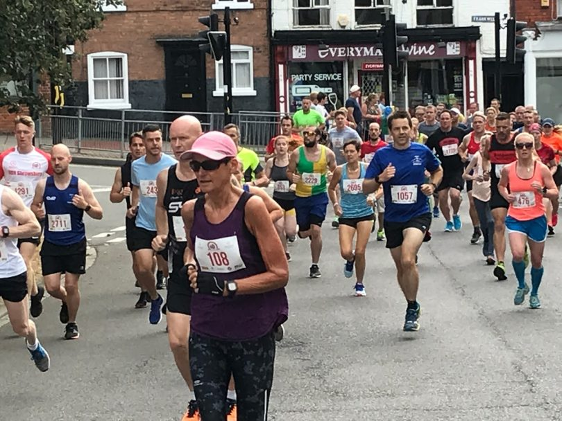 Shrewsbury 10k runners pass through Frankwell during last year's event which took place in July after snow postponed the event in March