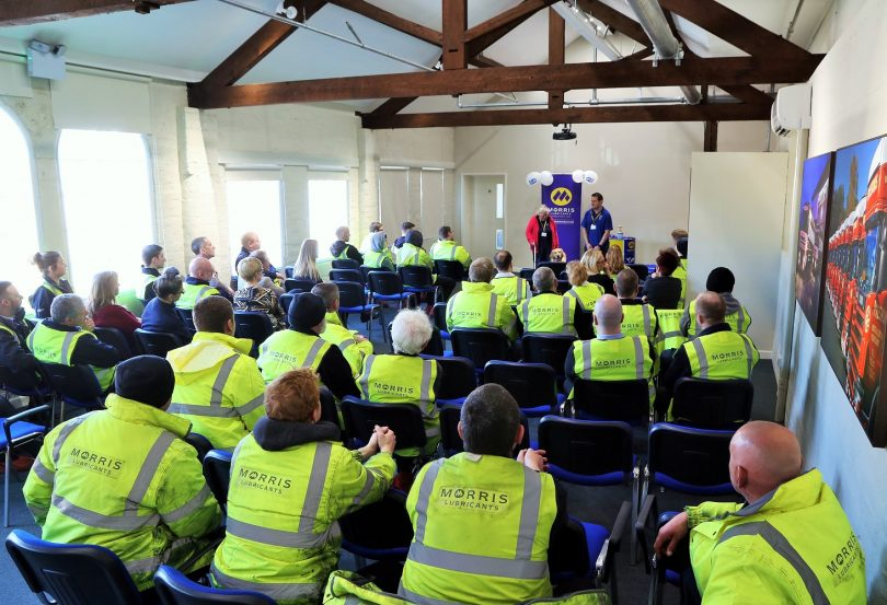 Rosemary, with guide dog Barney, gives a talk to Morris Lubricants staff