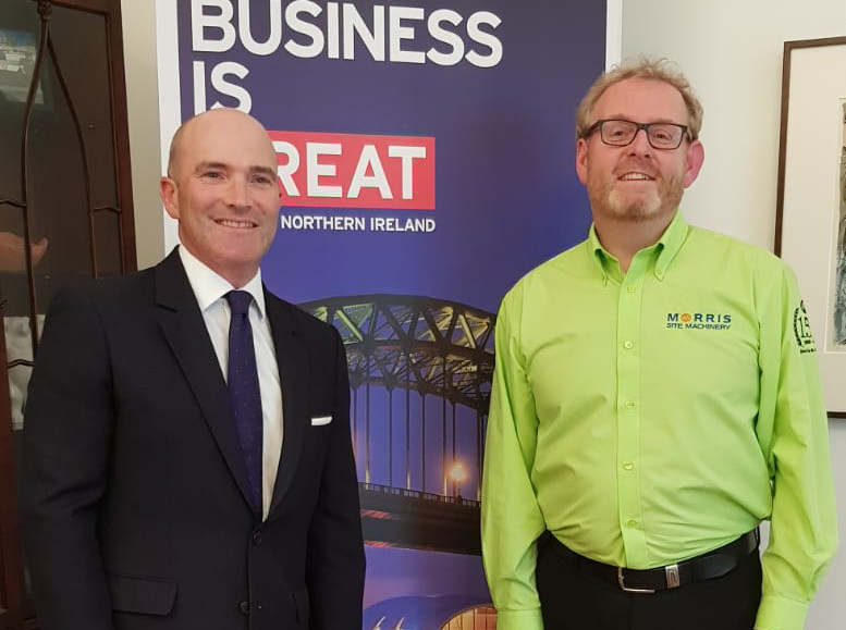 of British Consul-General Simon Kendall and Phil Winnington, Morris Site Machinery's International Business Director, in Munich