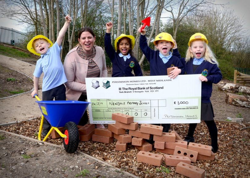 Pupils Finlay Kilford, Shanel Silva, Maddison Tidmarsh and Jack Steward join Amanda Rogers, head of sales at Persimmon Homes West Midlands, to celebrate the donation