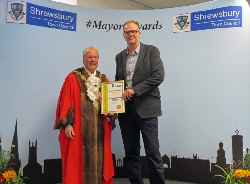 Mayor of Shrewsbury, Cllr Peter Nutting (left) presenting Historic England's Alastair Godfrey – Project Lead for the Shrewsbury Flaxmill Maltings restoration (right) with the Gold award certificate