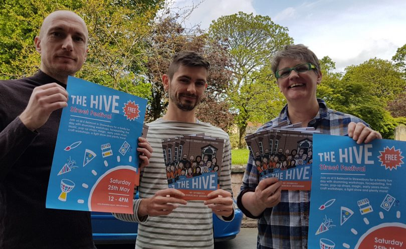 Tony Clarkson from The Hive's Creative Advisory Board preparing for the Street Festival with Daniel Lloyd, Digital Marketing Manager, and Sal Hampson, Project Manager