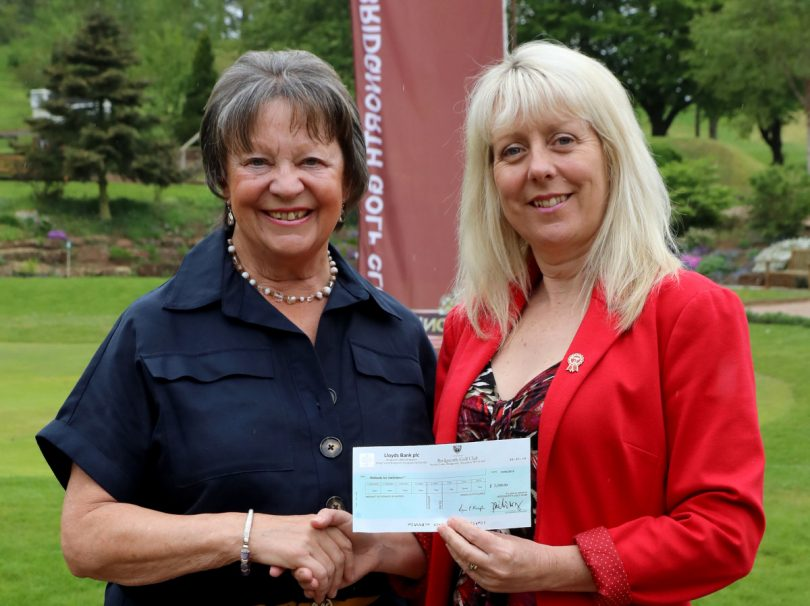 Bobby Darley presents a cheque to Maria Jones, Area Representative for Midlands Air Ambulance
