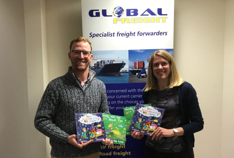 Global Freight Managing Director Anton Gunter is pictured with author and Rural Schools Project founder Lorna McCann