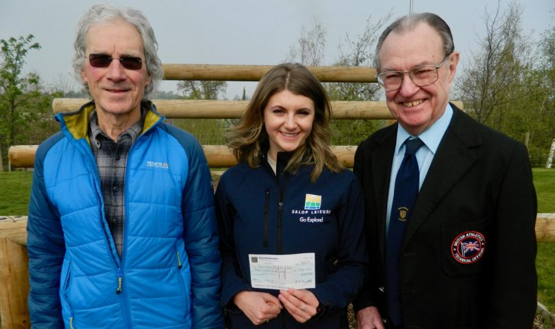 Derek Hayward, right, the president of Shrewsbury Athletic Club, receives a sponsorship cheque from Laura Wilde of Salop Leisure's marketing team, watched by, left, Ian Allport, the club chairman and senior coach