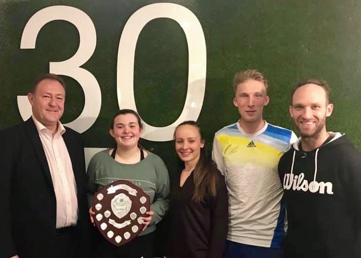 Simon Jones, left, the chair of Tennis Shropshire, presents the Mackenzie Shield to The Shrewsbury Club team, from left, Amy Dannatt, Hanna Cadwallader, captain Luke Henley and Adam Wharf