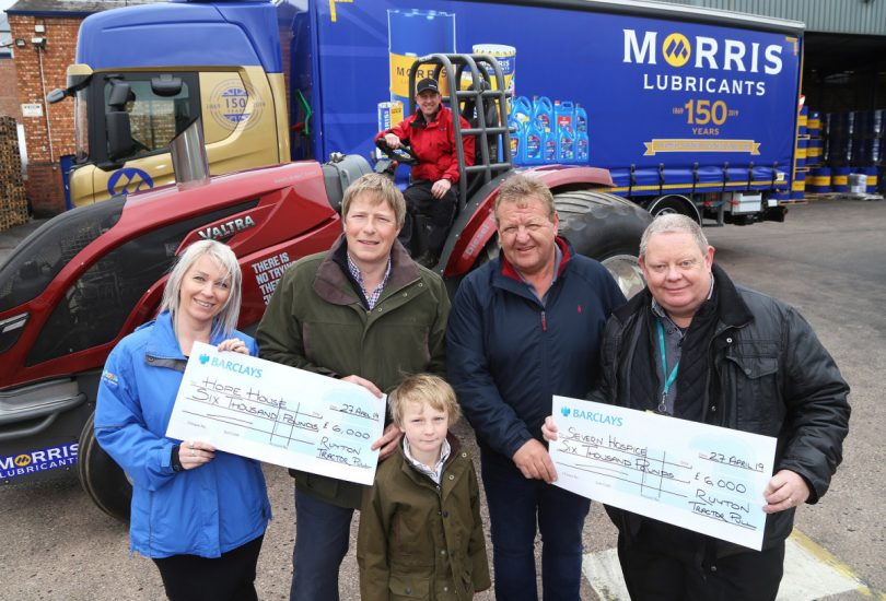 Lynsey Kilvert of Hope House, and Andy Perkins of Severn Hospice, receive the proceeds of the latest Ruyton X1 Towns charity tractor pull at Morris Lubricants. They are pictured with Andrew Goddard, Gary Penton, Gareth Jones, and six-year-old George Goddard