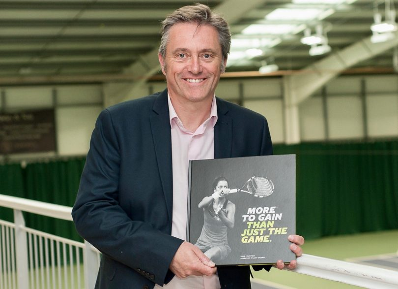Author Dave Courteen with a copy of More To Gain Than Just The Game at The Shrewsbury Club