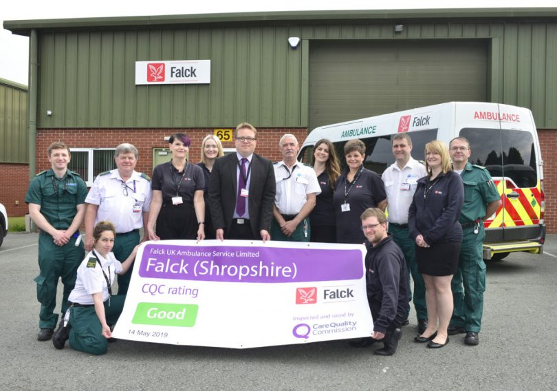 Proudly displaying their banner, Mark Rawlings (centre) with just a few of the team at Falck Ambulance UK at Atcham