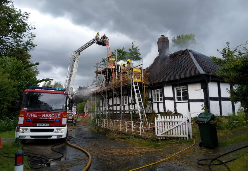 Firefighters work at the scene of the fire in Hopton Castle. Photo: @SFRS_CravenArms