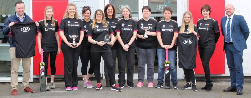 Dan Foskett (left) from Furrows and Ray Collins (right) from Beacon Cricket Club with the women's team and their new kit
