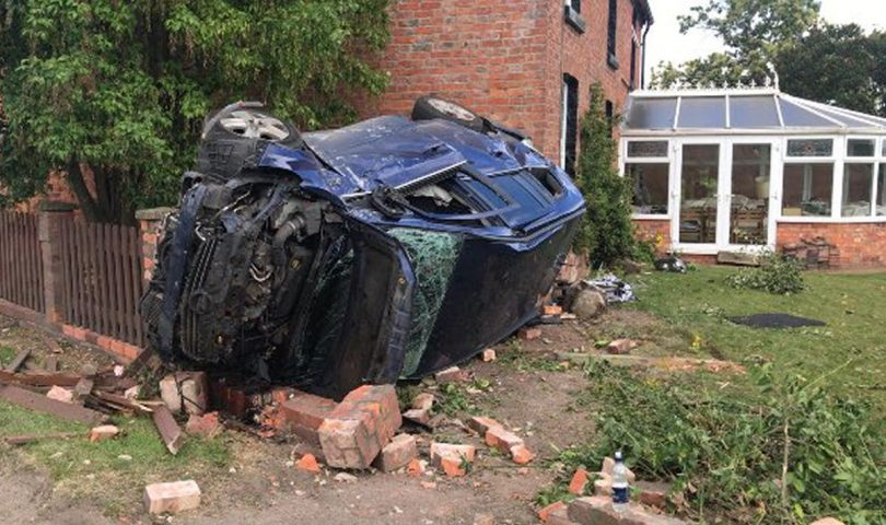The vehicle ended up on its side in a garden. Photo: West Mercia Police