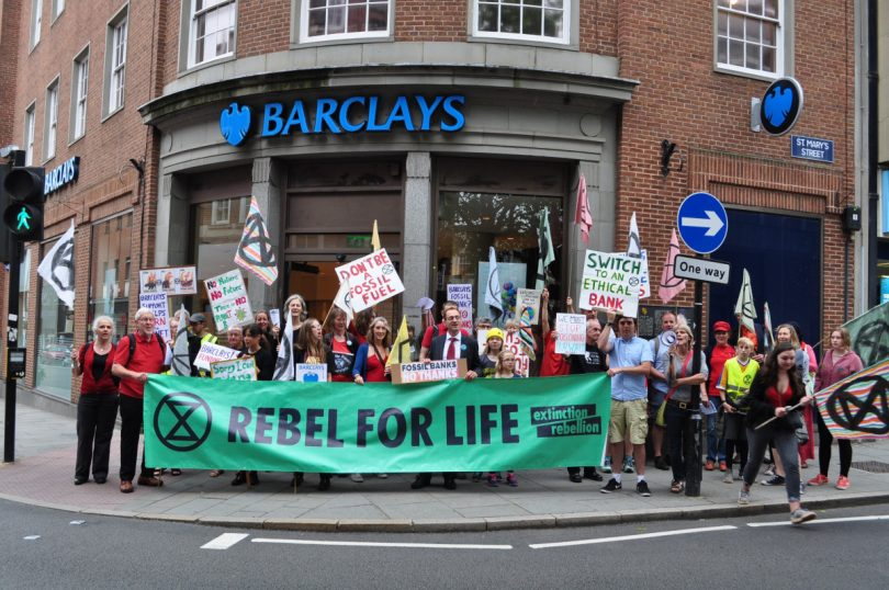 Extinction Rebellion Shrewsbury held a protest protest about the Barclays multibillion-pound funding of fossil fuel corporations