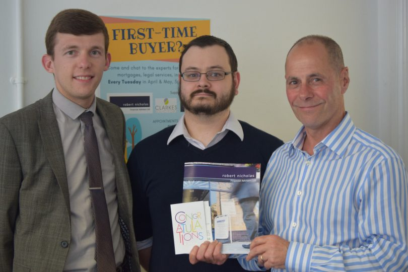 Steve Graves and Lee Taylor of Robert Nicholas Financial Advisers pictured with competition winner and first-time buyer Daniel Burton